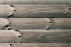 The aged brown planks. The wood texture. The background. Royalty Free Stock Photography