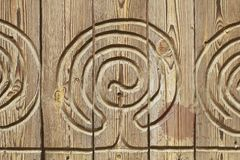 Aged brushed wood with carved ornament texture. Pattern of aged brushed wood with carved ornament in high resolution Stock Photos