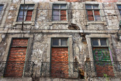 Aged Building Brick Covered Windows Royalty Free Stock Photos