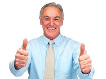 Aged business man showing a thumbs up over white Royalty Free Stock Photography