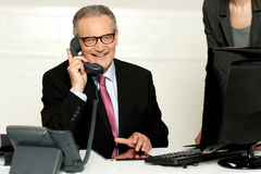 Aged businessman communicating on phone Stock Photos