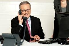 Aged businessman communicating on phone Stock Photos
