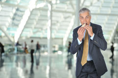 aged businessman eating middle sandwich Стоковое Фото