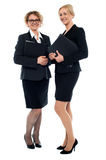 Aged businesswomen posing with documents Royalty Free Stock Photo