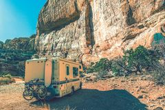 Aged Camper in the Canyon. RV Utah Trip in Vintage Color Grading Stock Image