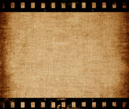 Aged canvas texture with film strip border Stock Images