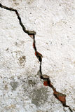 Aged cement wall texture. Very old wall with a crack on it Stock Photography
