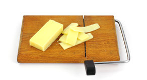 Aged Cheddar Cheese, Slices, Cutting Board Stock Photos