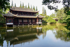 Aged Chinese building in lake on sunny summer day Royalty Free Stock Images
