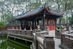 Aged Chinese building by pond Royalty Free Stock Photography