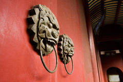 Aged Chinese door lockers on red gate Royalty Free Stock Photos