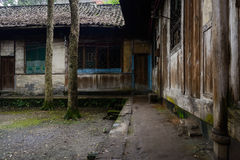 Aged Chinese dwelling houses after summer rain Stock Image