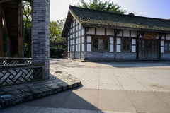 Aged Chinese timber framed house at sunny winter noon Royalty Free Stock Photo