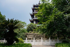 Aged Chinese tower in blue summer sky Royalty Free Stock Photo