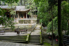 Aged Chinese traditional buildings in hillside woods Royalty Free Stock Photo