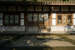 Aged Chinese traditional wooden house at sunny winter noon Stock Photo