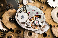 Aged clock mechanism macro vie. Retro hand watches parts on bronze gears background Stock Photo