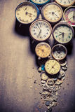 Aged clocks in pile. Closeup of aged clocks in pile Royalty Free Stock Image