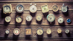 Aged clocks on the wall Stock Images