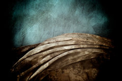 Aged cloths. A grey mottled backdrop is draped over a blue mottled backdrop cloth Stock Images