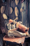 Aged cobbler workplace with tools, leather and shoes Stock Photo