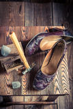 Aged cobbler workshop with brush and shoes Royalty Free Stock Images