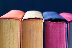 Aged colorful books with colored spines and pages Royalty Free Stock Photos