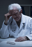 Aged concerned physcician Royalty Free Stock Photo