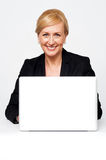 Aged corporate lady working on a laptop Stock Image