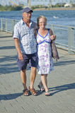 Aged couple. Aged loving couple walking and holding each other Stock Photo