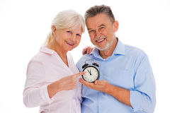 Aged couple with alarm clock Stock Images