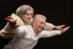 Aged couple on black Stock Photo