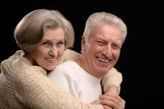 Aged couple on black Royalty Free Stock Photo