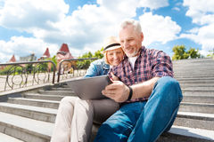 Aged couple enjoying each other Royalty Free Stock Image