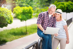 Aged couple enjoying each other Stock Photography