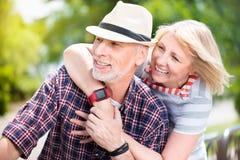 Aged couple enjoying each other Stock Photo