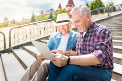 Aged couple enjoying each other Royalty Free Stock Images
