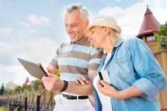 Aged couple enjoying each other Stock Photos