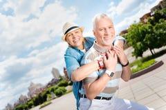 Aged couple enjoying each other Stock Photography