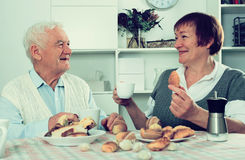 Aged couple enjoying evening stock photography