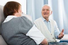 Aged couple enjoying evening Royalty Free Stock Image