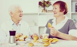 Aged couple enjoying evening Stock Images