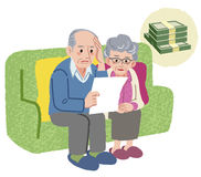 Aged couple with financial problem. Aged couple sitting on the sofa and checking bills Stock Image