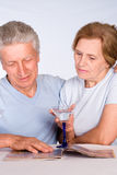 Aged couple with glass Royalty Free Stock Images