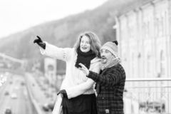 Aged couple happy standing on bridge. Woman and man pointing out royalty free stock images