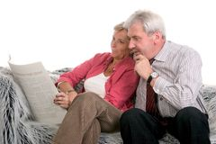 aged couple mid reading together Στοκ Εικόνες