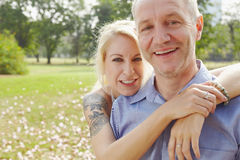 Aged couple in the park b Stock Photos
