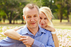 Aged couple in the park d Stock Photo