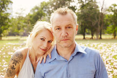 Aged couple in the park Stock Photography