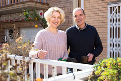 Aged couple in a patio Stock Photo